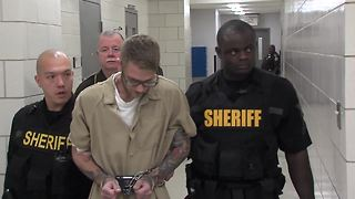 Man accused of killing Southport police officer walks to court - Video