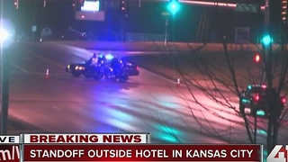 Police working active standoff at hotel in KCMO - Video