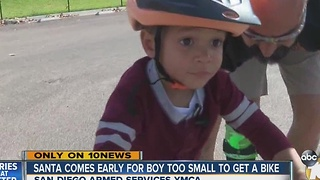 Santa delivers early Christmas present to boy who didn't receive a bike - Video