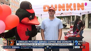 Orioles pitcher serves coffee and donuts to fans
