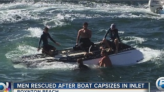 Men rescued after boat capsizes - Video