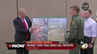President tours border wall prototypes
