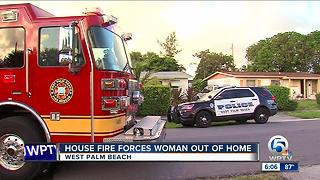 Fire forces woman out of home in West Palm Beach - Video