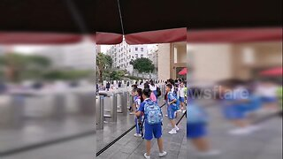 Chinese pupils scan faces at facial recognition gate to enter school