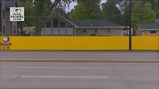 Painting a fence for a good cause