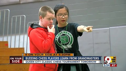 Budding chess players learn from grandmasters