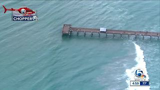 Pier left damaged from rough surf - Video