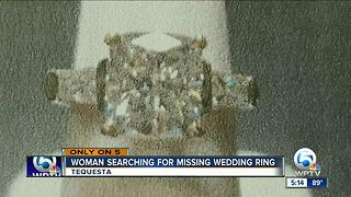 Woman searching for missing wedding ring - Video