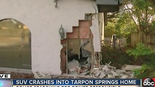 SUV crashes into Tarpon Springs home - Video