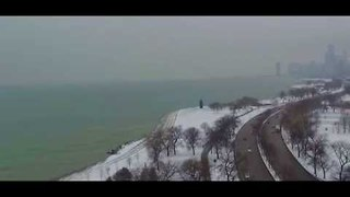 Drone Footage Shows Snowy Belmont Harbor in Chicago - Video