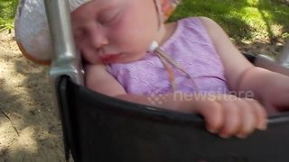Baby struggles to stay awake on swing - Video