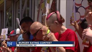 Burger eating contest winner is a familiar name - Video