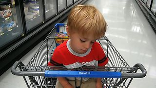 Cute Kid Falls Asleep While Shopping - Video