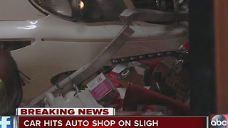 Car slams into auto shop on Sligh Avenue, driver on the run - Video