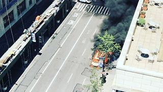 Taxi Catches Fire on Fifth Avenue in New York City - Video