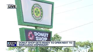 Donut shop getting ready to open next to marijuana dispensary - Video