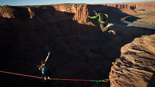 Stunt Couple Celebrate Anniversary With Simultaneous BASE Jump And Highline - Video