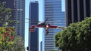 Skycrane Helicopter Hovers Above Downtown LA - Video