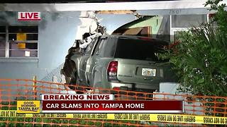 SUV plows through wall of Tampa home - Video