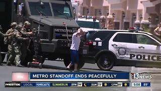 Man in custody after barricade situation - Video
