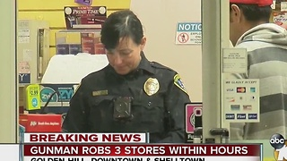 Gunman robs three stores within hours - Video