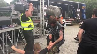 Policeman rocks out to heavy metal band at UK festival