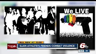 Slain athlete's friends combat violence - Video
