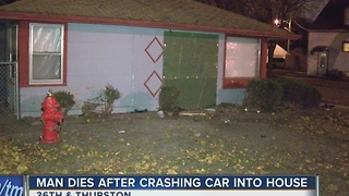 Man dies after crashing car into house - Video