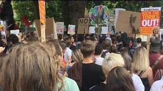 Protesters Throng Road Outside Downing Street