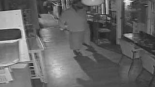 SURVEILLANCE VIDEO: Burglary suspect squeezes through window of St. Pete restaurant - Video