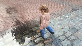 Toddler discovers a puddle, knows exactly what to do!
