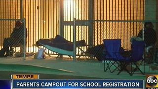 Parents camping out overnight for school registration - Video