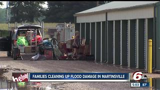 Families clean up flood damage in Martinsville - Video