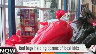 Dozens of red bags help families in need - Video