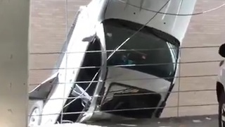 Austin Man Drives Off Parking Garage; Car Dangles Midair - Video