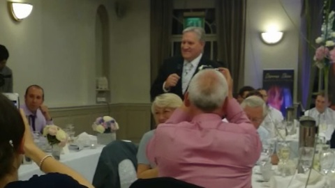 Father of the bride's surprise Elvis performance