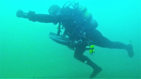 Scuba diver can't resist funny antics in fast flowing river