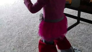 Toddler wears Christmas stockings on her feet - Video