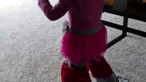 Toddler wears Christmas stockings on her feet