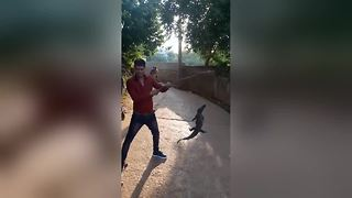 Villagers in trouble for torturing baby crocodile, posing for selfies - Video