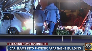 Car slams into Phoenix apartment building - Video