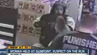 Woman grabbed by armed robber, held at gunpoint during robbery at Pueblo convenience store - Video