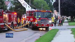 Crews battle fire in Oshkosh home