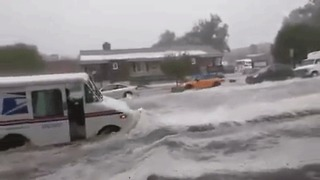 US Postal Truck Slammed by Floodwaters in Colorado Springs - Video
