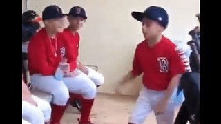 In a Little League of His Own: Young Baseball Player Gets His Team Fired Up Before Their Game