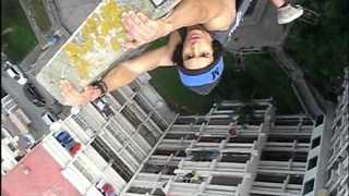 Moroccan Daredevil Does Pull-Ups Off Side of Building - Video