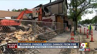 Business owners assess damage from fire - Video