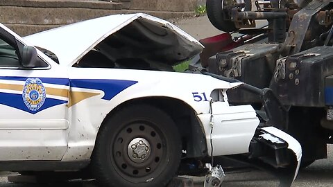 Car crashes into police cruiser leading funeral procession