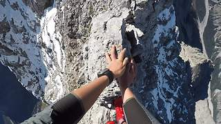Adventurous Mountain Climber Scales Deadly Knife-Edge Ridge