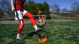 Soccer Player Shows Off Skill With Flaming Ball - Video